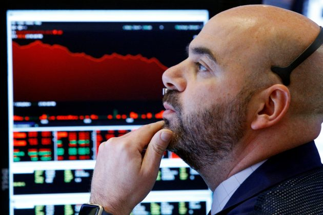 A trader watches his screens on the floor of the New York Stock Exchange in New York, U.S., February 5, 2018.