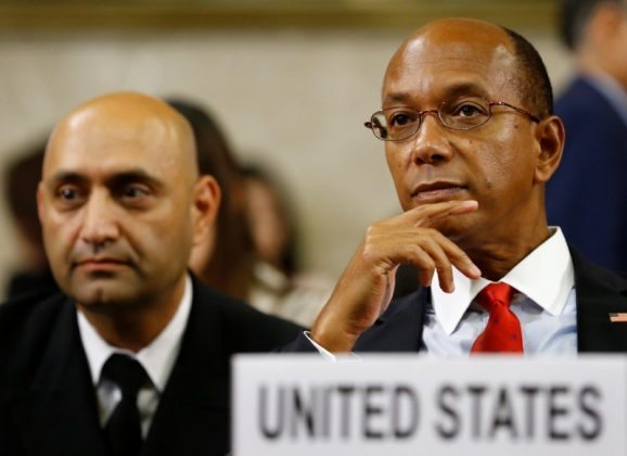 U.S. Ambassador Robert Wood (R) waits next to U.S. Army Captain Murzban Morris of the Departement of Defense Joint Staff before their address on North Korea to the Conference on Disarmament at the United Nations Office in Geneva, Switzerland August 30, 2017.