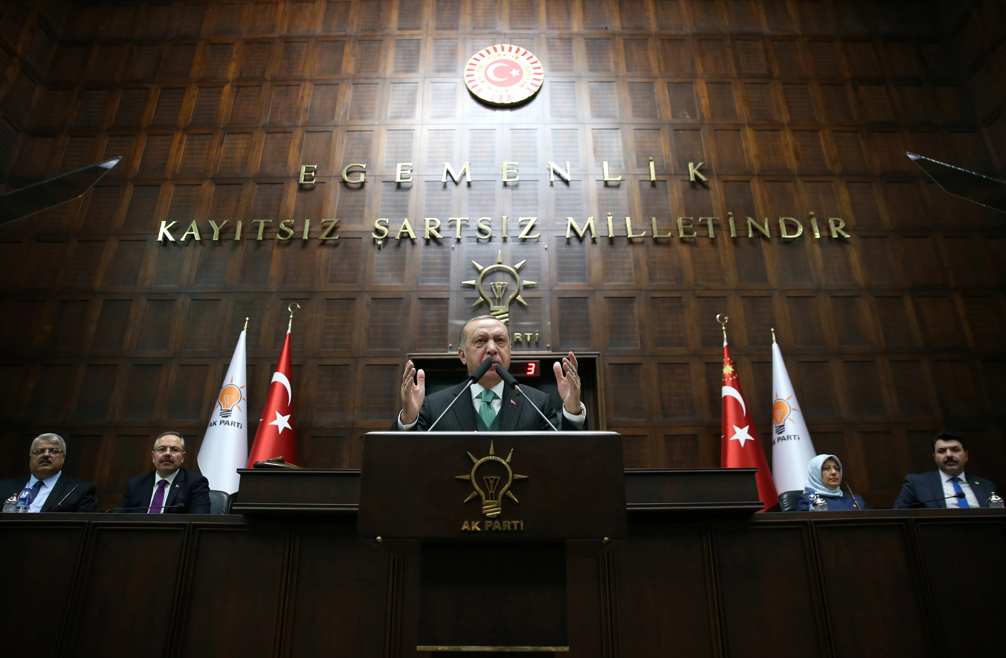 Turkish President Tayyip Erdogan addresses members of parliament from his ruling AK Party (AKP) during a meeting at the Turkish parliament in Ankara, Turkey, February 6, 2018.