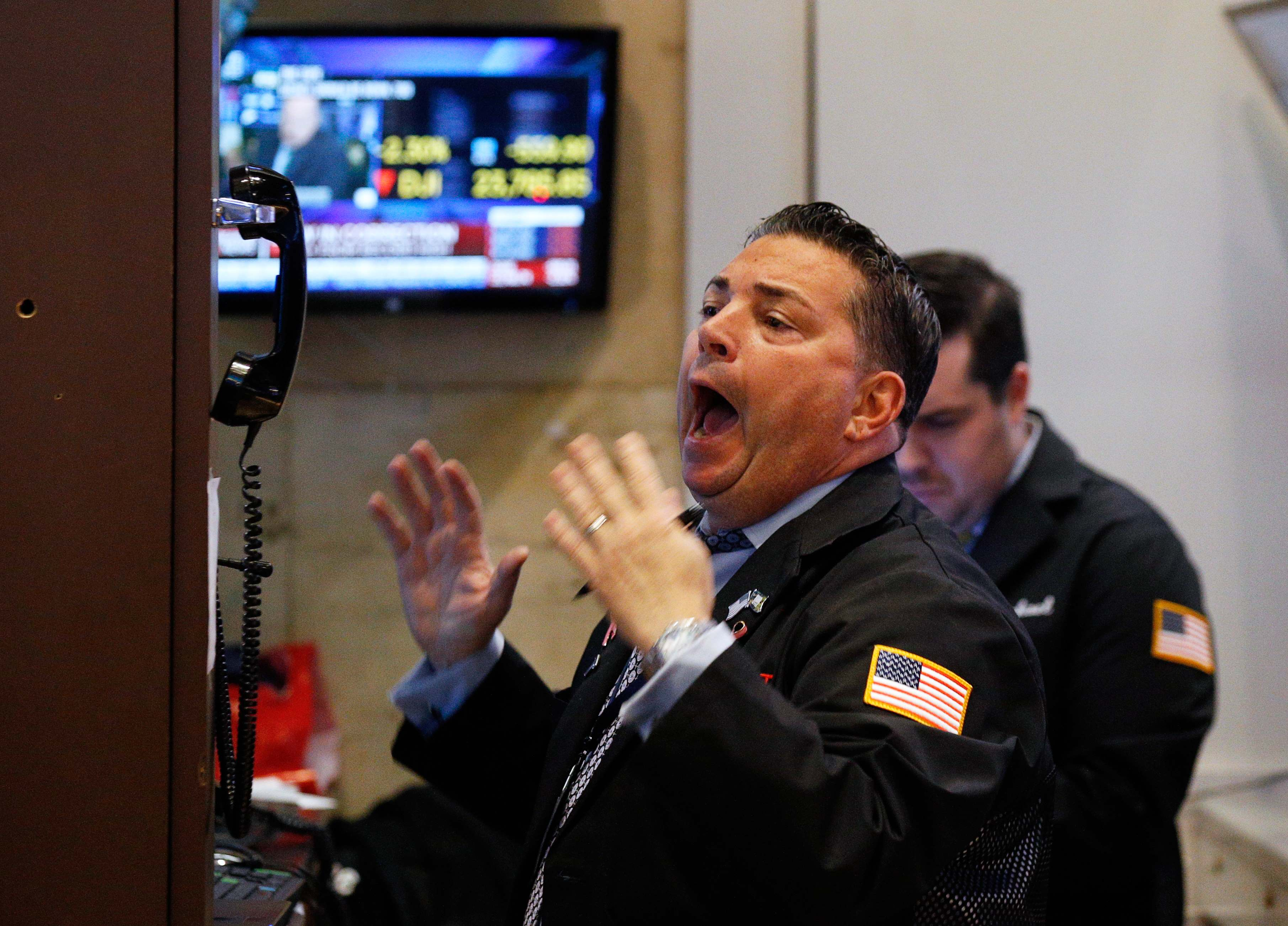 A trader reacts on the floor of the New York Stock Exchange in New York, U.S., February 6, 2018.