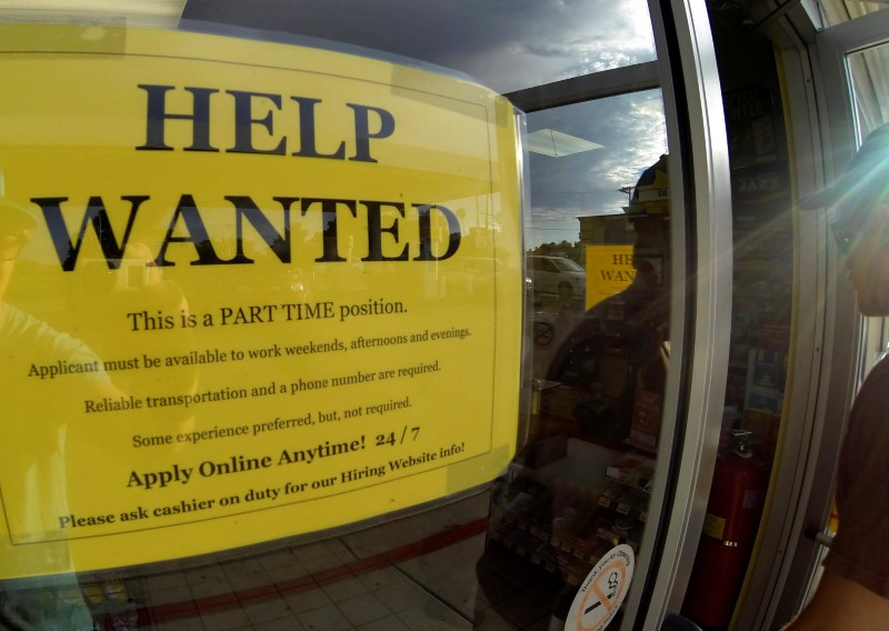 : A help wanted sign is posted on the door of a gas station in Encinitas, California, U.S., September 6, 2013.