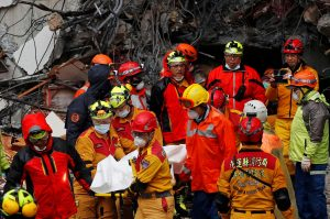 A body of employee of collapsed Marshal Hotel is carried by a rescue personnel after an earthquake hit Hualien, Taiwan February 7, 2018.