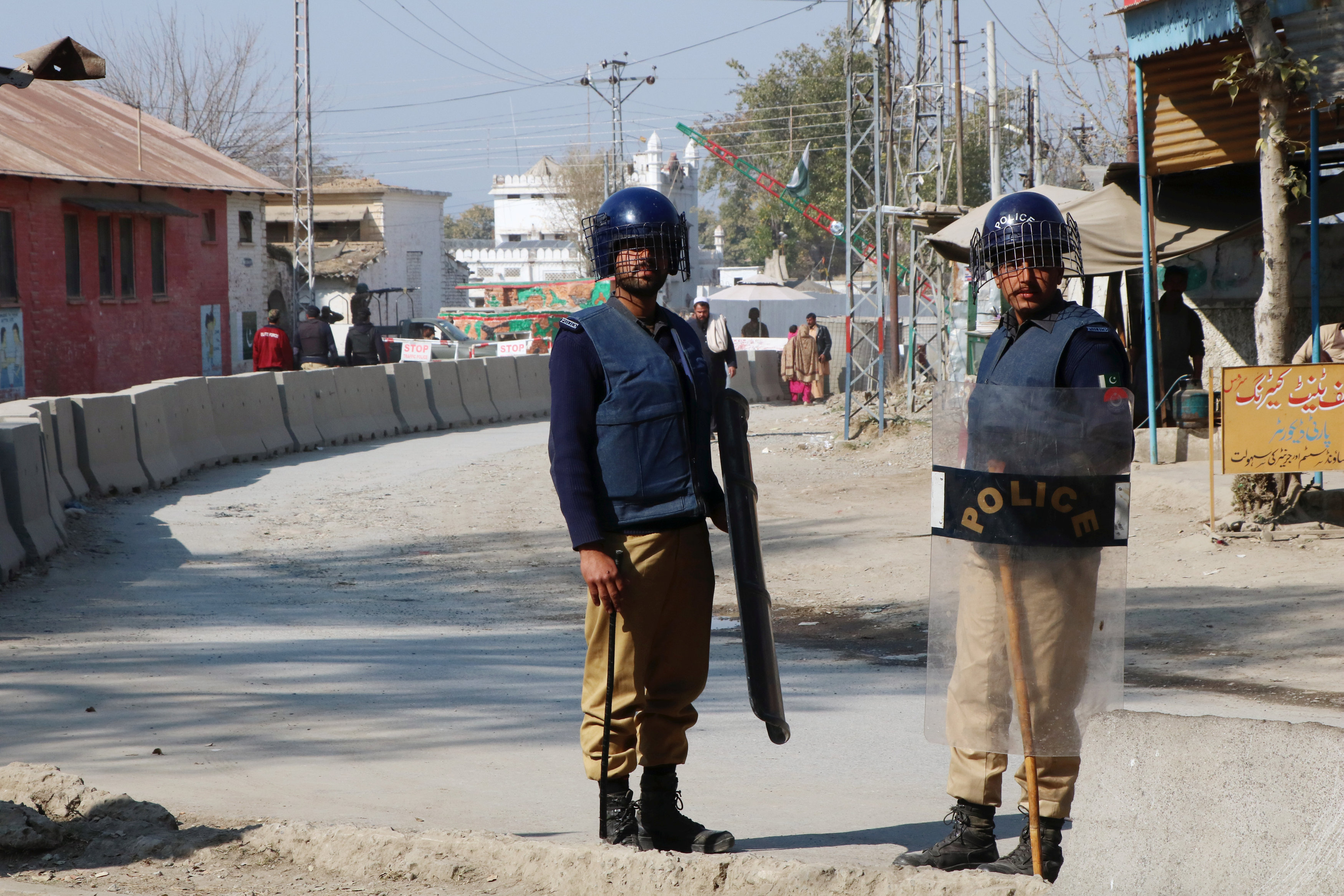 Policemen keep guard near the central prison where a court convicted 31people over the campus lynching of a university student last year who was falsely accused of blasphemy, and sentenced one of them to death, in Haripur, Pakistan February 7, 2018.