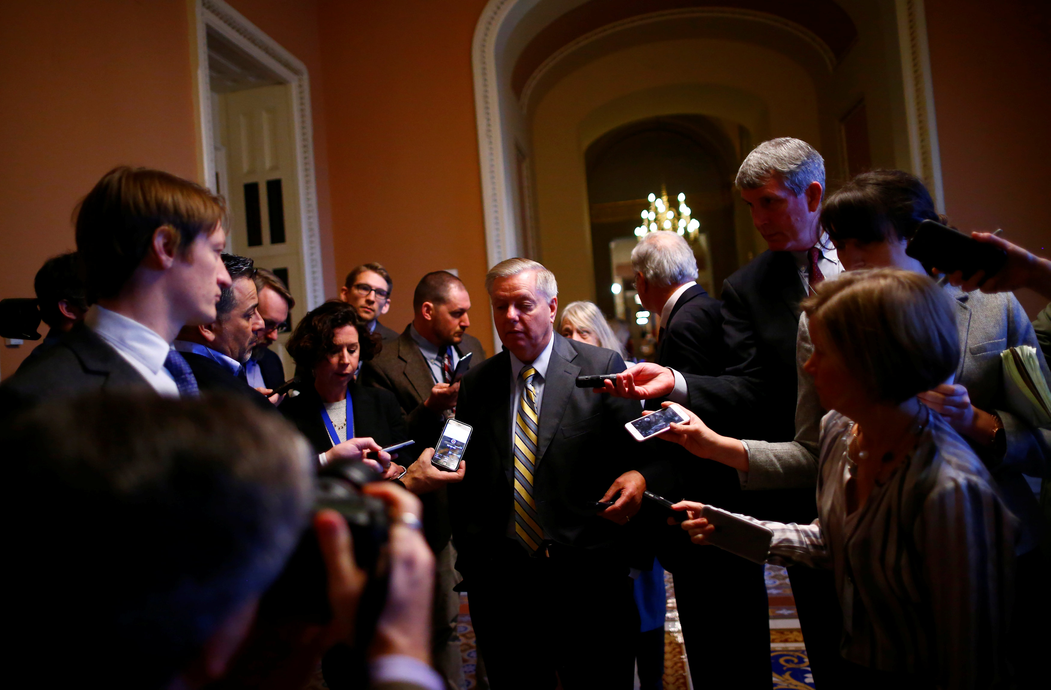 U.S. Sen. Lindsay Graham speaks to reporters outside the Senate chamber on Capitol Hill in Washington, U.S. February 7, 2018.