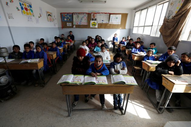 Students sit in a classroom at a school in Sahnaya, near Damascus Syria February 4, 2018. Picture taken February 4, 2018.