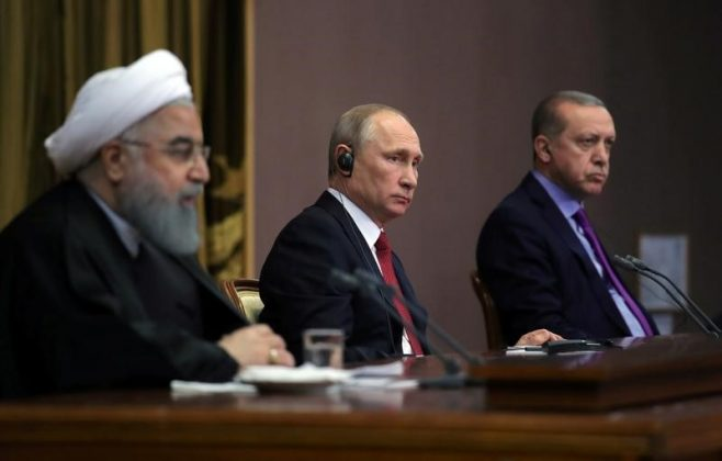 Iran's President Hassan Rouhani together with his counterparts, Russia's Vladimir Putin and Turkey's Tayyip Erdogan, attend a joint news conference following their meeting in Sochi, Russia November 22, 2017.