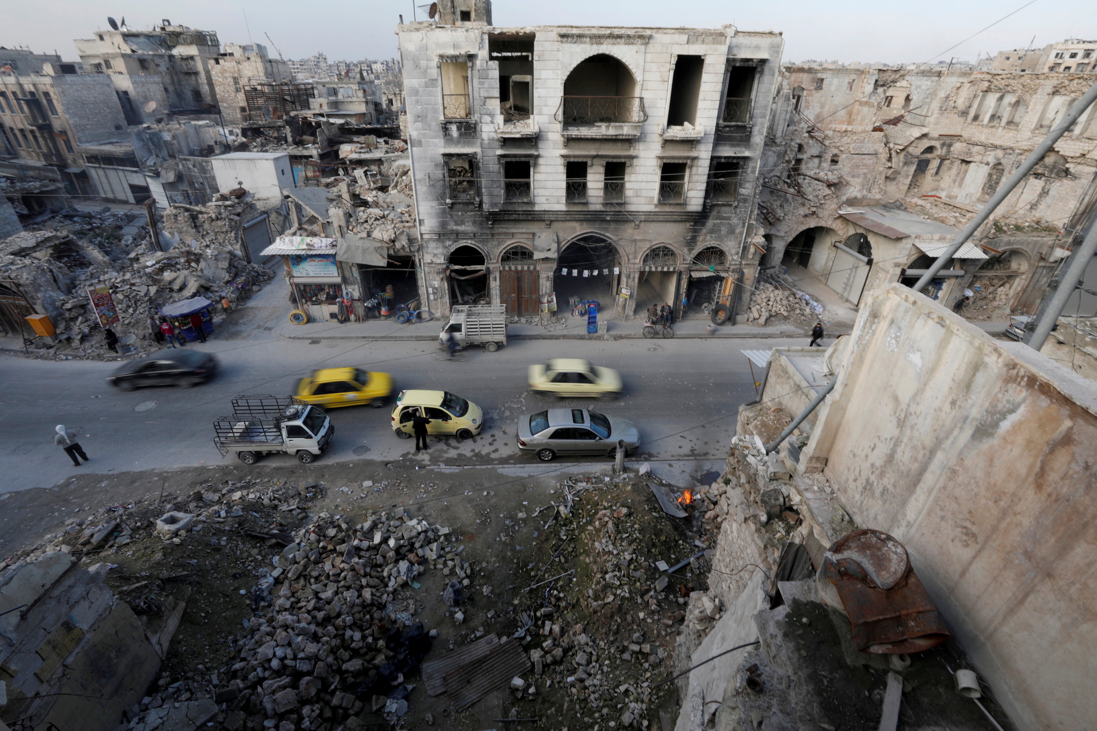 People and cars are seen in old town in Aleppo, Syria February 8, 2018.