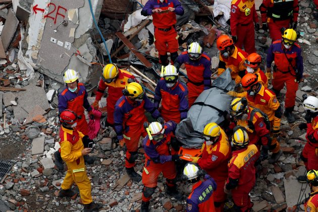 A body of a Hong Kong Canadian is carried out from a collapsed building after an earthquake hit Hualien, Taiwan February 9, 2018.