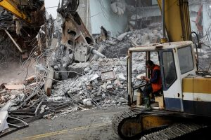 An excavator demolishes collapsed Marshal hotel after an earthquake hit Hualien, Taiwan February 9, 2018.