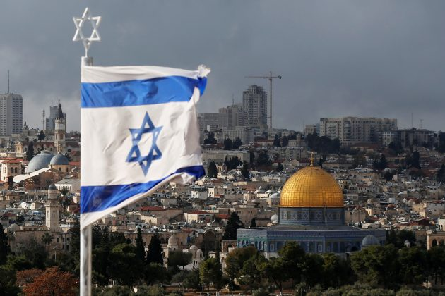 An Israeli flag is seen near the Dome of the Rock, located in Jerusalem's Old City on the compound known to Muslims as Noble Sanctuary and to Jews as Temple Mount December 6, 2017.