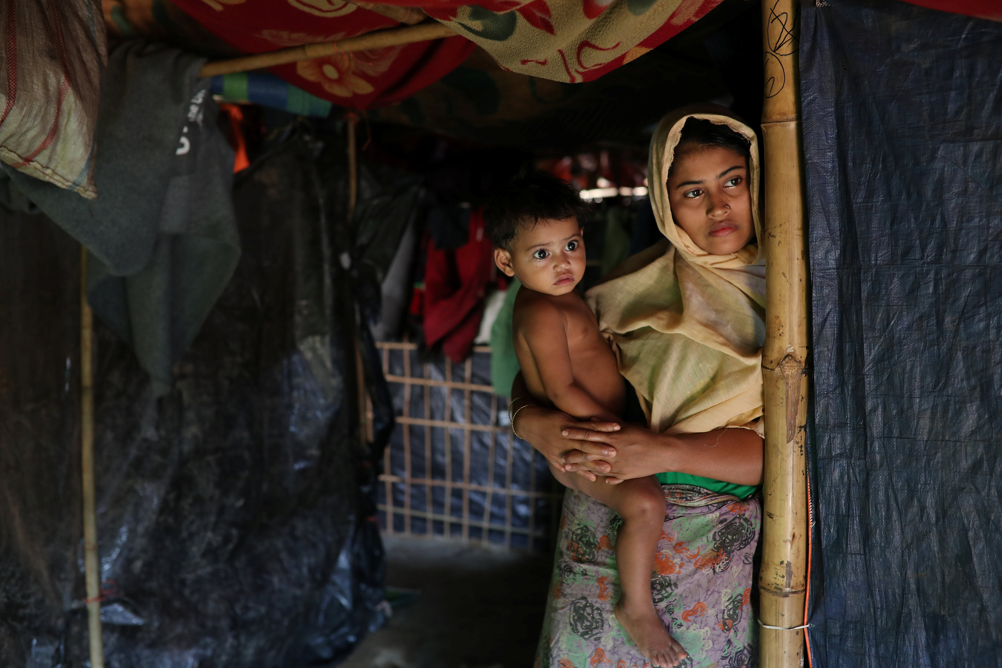 Rehana Khatun, whose husband Mohammed Nur was among 10 Rohingya men killed by Myanmar security forces and Buddhist villagers on September 2, 2017, poses for a picture with her child at Kutupalong camp in Cox's Bazar, Bangladesh, January 19, 2018. Picture taken January 19, 2018.
