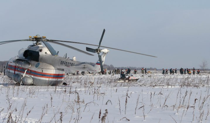 Russian Emergency Situations Ministry members work at the crash site of the short-haul AN-148 airplane operated by Saratov Airlines in Moscow Region, Russia February 12, 2018.