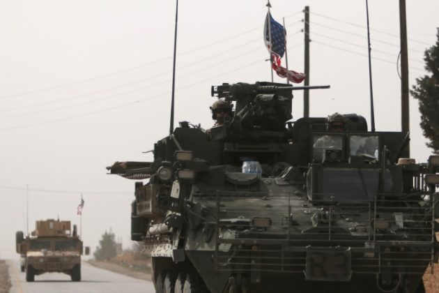American army vehicles drive north of Manbij city, in Aleppo Governorate, Syria March 9, 2017.