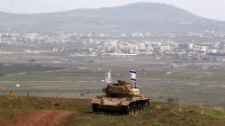 An old military vehicle can be seen positioned on the Israeli side of the border with Syria, near the Druze village of Majdal Shams in the Israeli-occupied Golan Heights, Israel February 11, 2018.