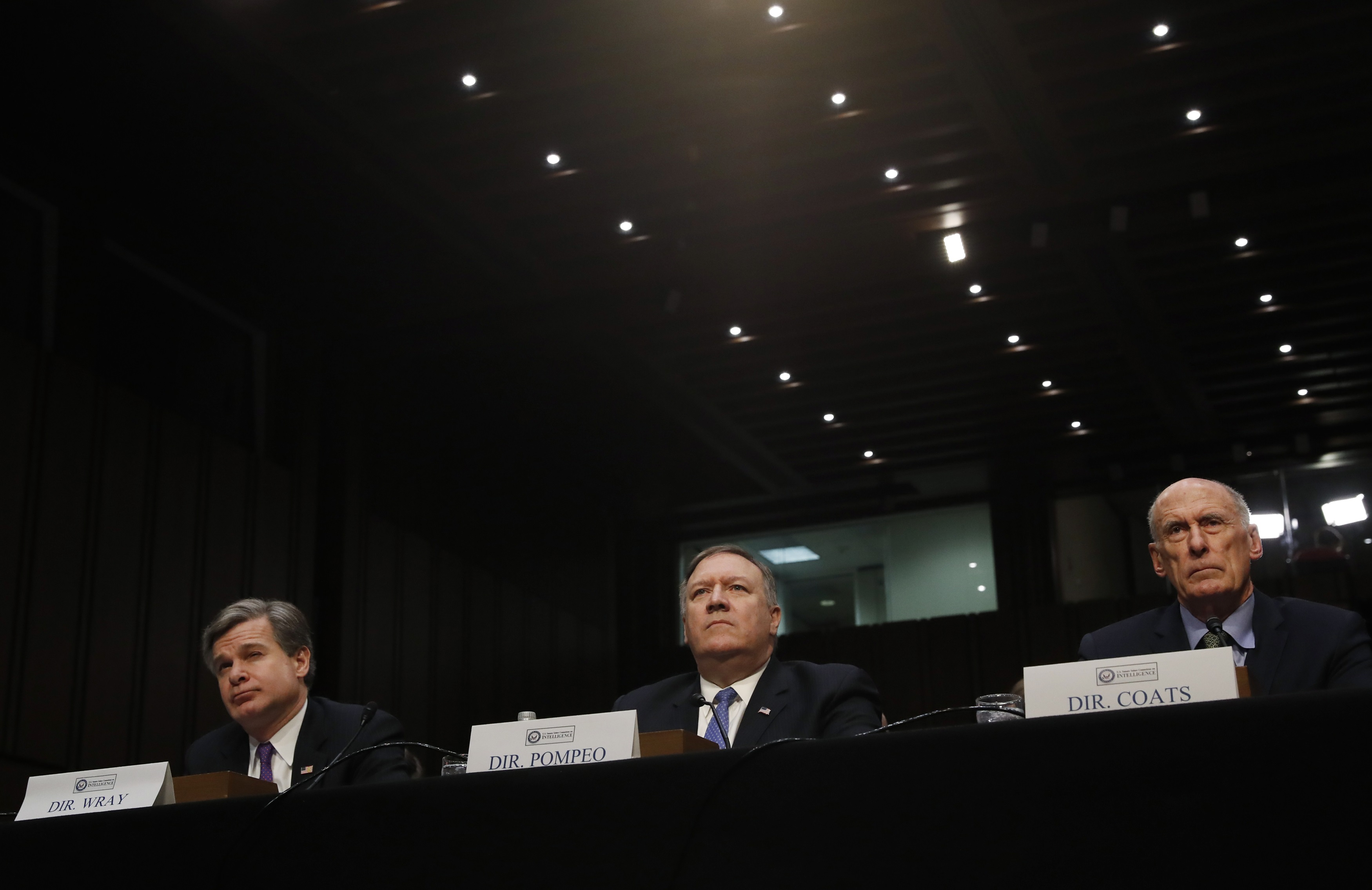 """Federal Bureau of Investigation (FBI) Director Christopher Wray; Central Intelligence Agency (CIA) Director Mike Pompeo; and Director of National Intelligence (DNI) Dan Coats testify before a Senate Intelligence Committee hearing on """"World Wide Threats"""" on Capitol Hill in Washington, U.S., February 13, 2018. REUTERS/Leah Millis"""
