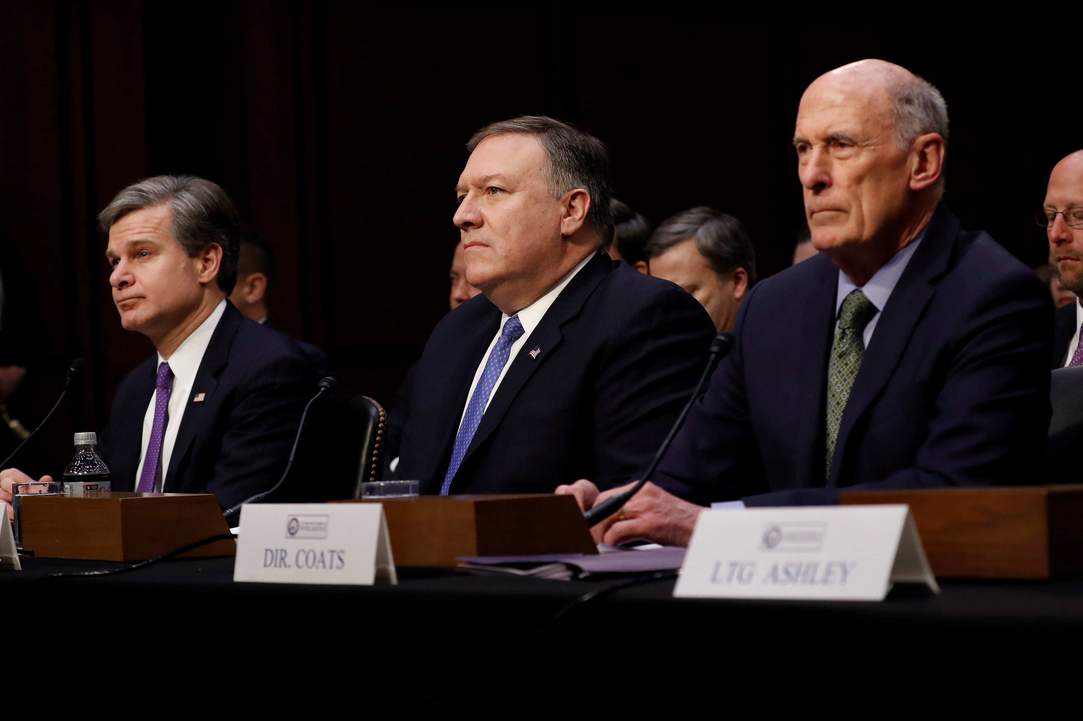 Federal Bureau of Investigation (FBI) Director Christopher Wray, Central Intelligence Agency (CIA) Director Mike Pompeo, and Director of National Intelligence (DNI) Dan Coats wait to testify before the Senate Intelligence Committee on Capitol Hill in Washington, U.S., February 13, 2018. REUTERS/Aaron P. Bernstein