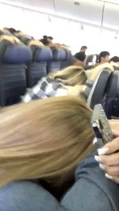 Passengers brace during the plane landing in Honolulu, Hawaii, U.S., February 13, 2018 in this still image taken from a social media video. Mariah Amerine/via REUTERS