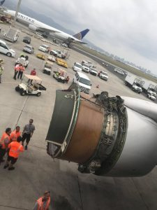 The plane with engine problems is seen on the tarmac in Honolulu, Hawaii, U.S., February 13, 2018 in this picture obtained from social media. Mariah Amerine/via REUTERS