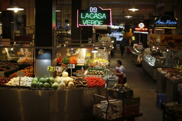 A man unloads vegetables at Grand Central Market in Los Angeles, California, March 9, 2015. REUTERS/Lucy Nicholson