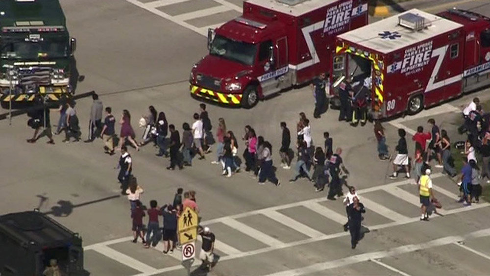 Students are evacuated from Marjory Stoneman Douglas High School during a shooting incident in Parkland, Florida, U.S. February 14, 2018 in a still image from video. WSVN.com via REUTERS