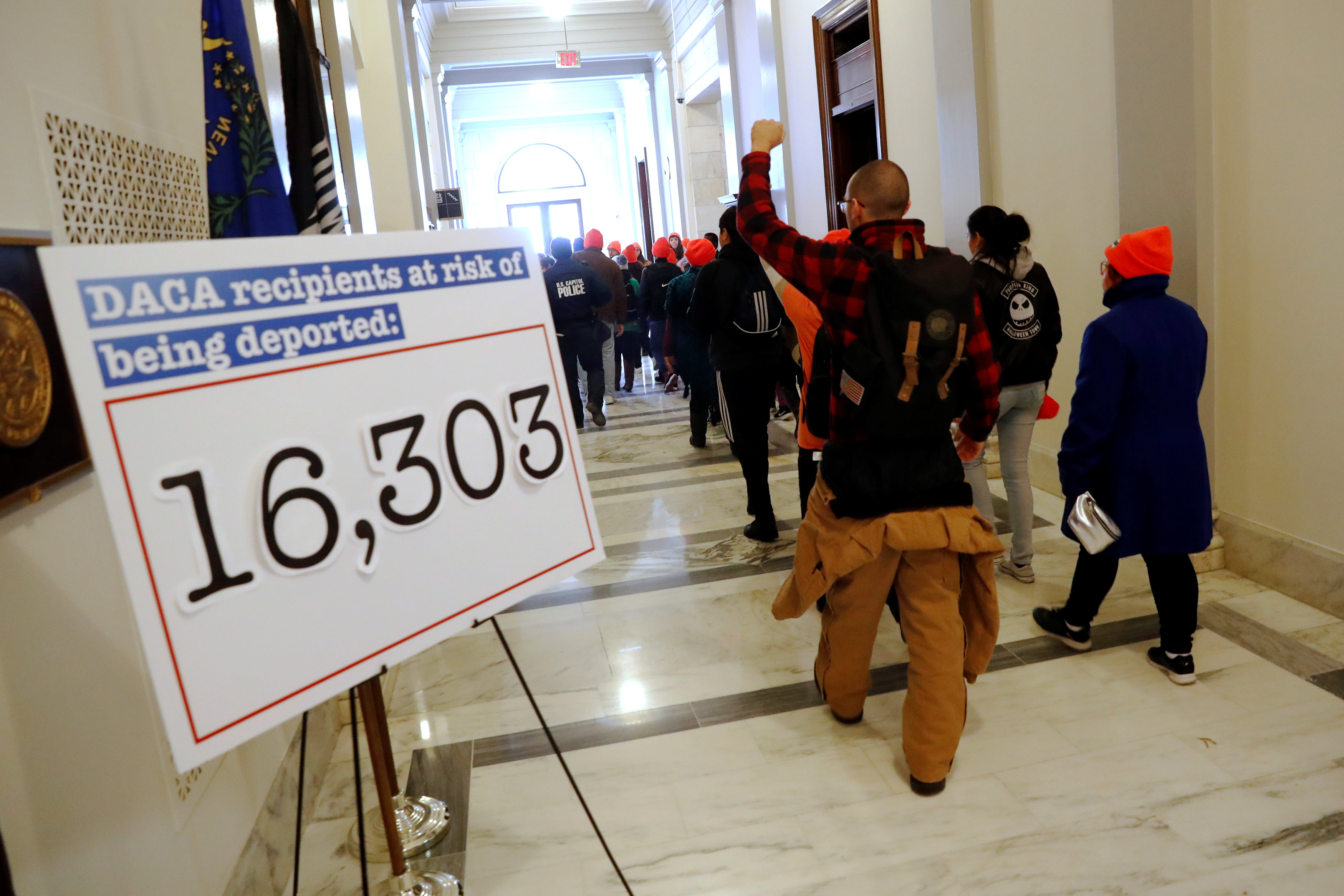 "Demonstrators calling for new protections for so-called ""Dreamers,"" undocumented children brought to the U.S. by their immigrant parents, walk through a senate office building on Capitol Hill in Washington, U.S. January 17, 2018. REUTERS/Jonathan Ernst"