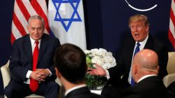 FILE PHOTO - U.S. President Donald Trump speaks with Israeli Prime Minister Benjamin Netanyahu during the World Economic Forum (WEF) annual meeting in Davos, Switzerland January 25, 2018. REUTERS/Carlos Barria