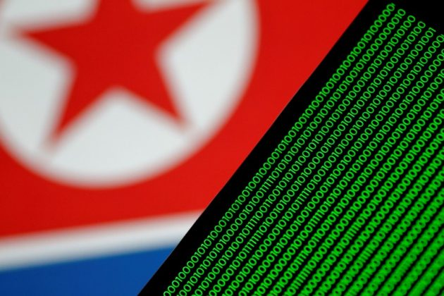 Binary code is seen on a screen against a North Korean flag in this illustration photo November 1, 2017. REUTERS/Thomas White/Illustration