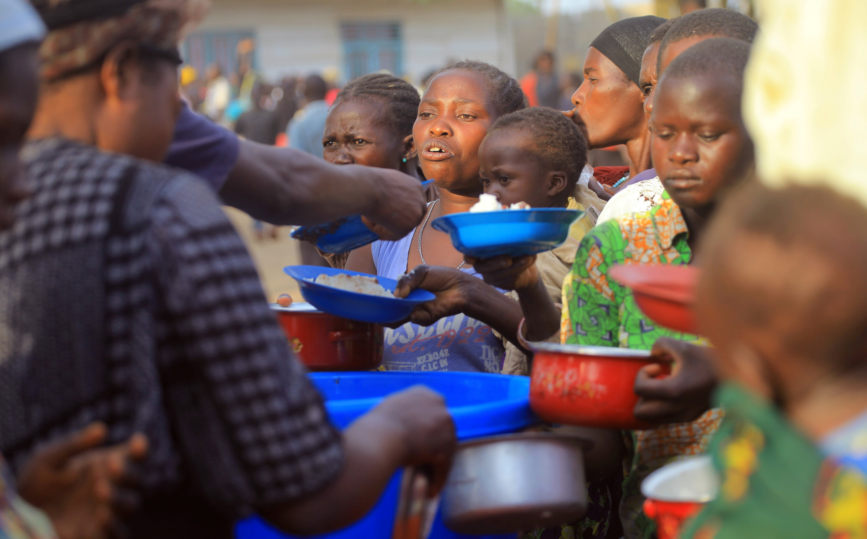 Internally displaced Congolese civilians receive food aid at Medecins Sans Frontieres (MSF) centre in Bunia, eastern Democratic Republic of Congo February 16, 2018. Picture taken February 16, 2018. REUTERS/Stringer