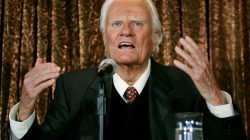 Evangelist Billy Graham speaks to members of the media at a news conference in New York, U.S. June 21, 2005. REUTERS/Mike Segar/File Photo