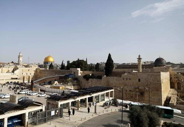 A general view of Jerusalem's Old City shows the Western Wall, Judaism's holiest prayer site, in the foreground as the Dome of the Rock, located on the compound known to Muslims as Noble Sanctuary and to Jews as Temple Mount, is seen in the background January 22, 2018. REUTERS/Ammar Awa