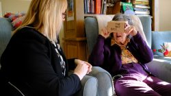 Daphne Padfield, 93, tries out a specialist virtual reality headset at the Langham Court Dementia Home in Hindhead, Britain February 6, 2018. REUTERS/Matt Stock