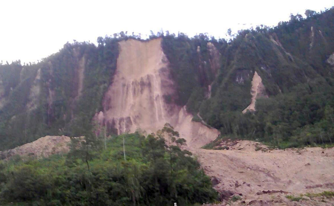 A supplied image shows a landslide and damage to a road located near the township of Tabubil after an earthquake that struck Papua New Guinea's Southern Highlands, February 26, 2018. Jerome Kay/Handout via REUTERS