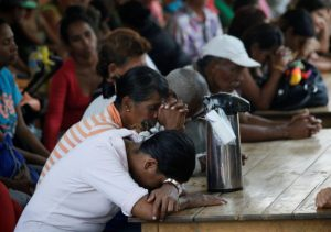 Venezuelans pray as they gather at a dining facility organised by Caritas and the Catholic church, in Cucuta, Colombia February 21, 2018. REUTERS/Carlos Eduardo Ramirez