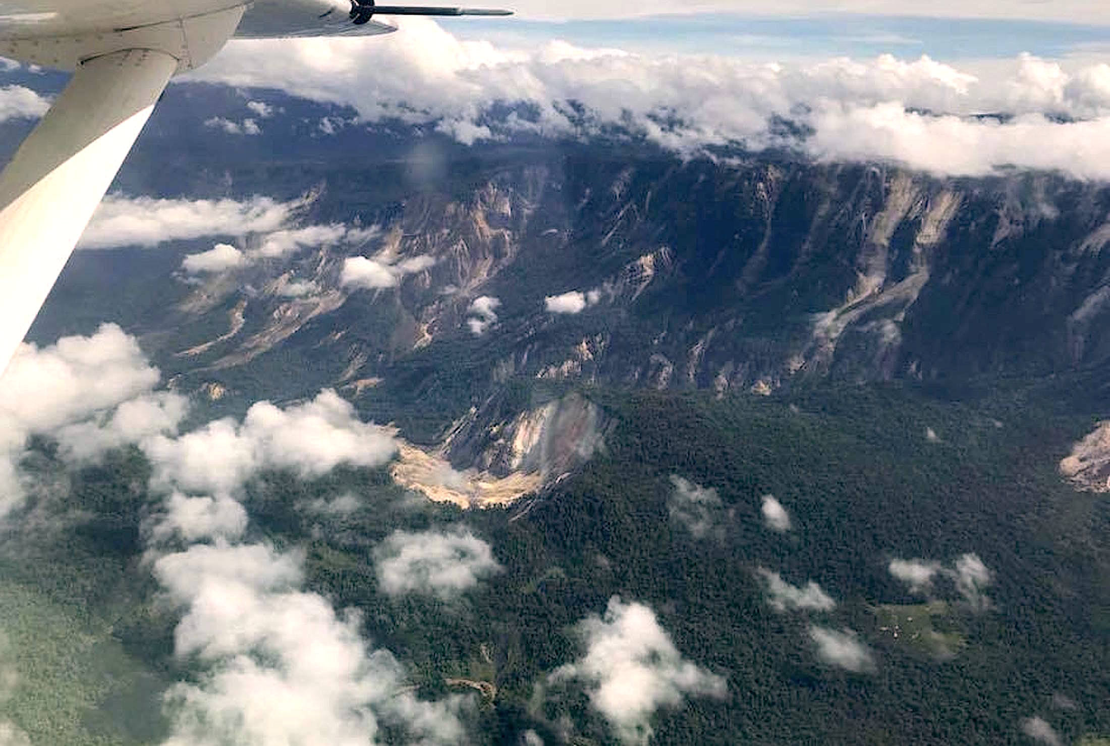 A handout photo shows several landslides on mountains in the Muller range after an earthquake struck Papua New Guinea's Southern Highlands February 26, 2018. Picture taken February 26, 2018. Steve Eatwell-Mission Aviation Fellowship/Handout via REUTERS