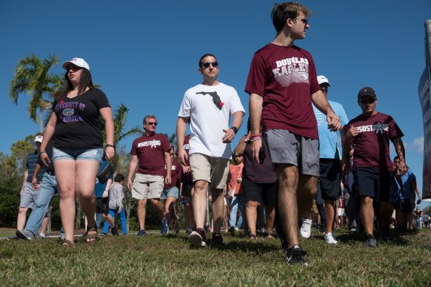 Students and parents arrive for voluntary campus orientation at the Marjory Stoneman Douglas High School, for the coming Wednesday's reopening, following last week's mass shooting in Parkland, Florida, February 25, 2018. REUTERS/Angel Valentin