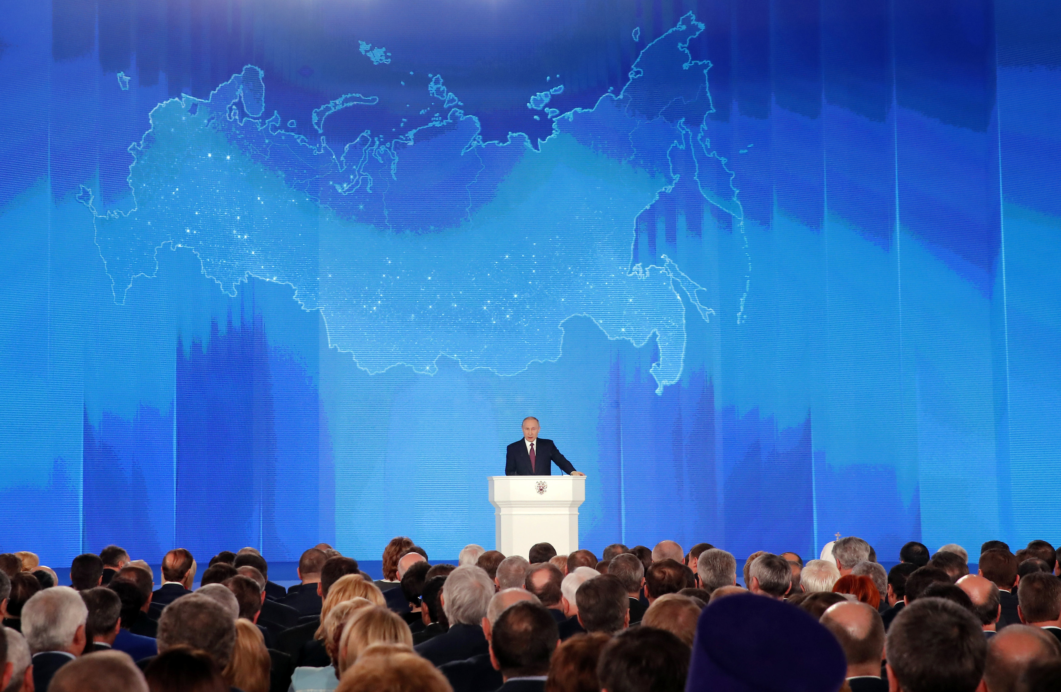 Russian President Vladimir Putin addresses the Federal Assembly, including the State Duma parliamentarians, members of the Federation Council, regional governors and other high-ranking officials, in Moscow, Russia March 1, 2018. REUTERS/Maxim Shemetov