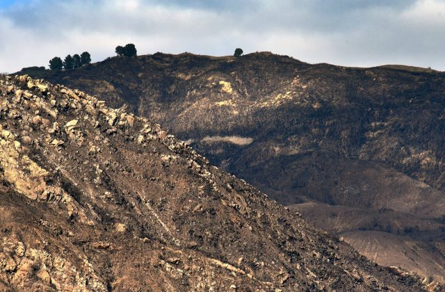 Barren hills, which were charred by the Thomas wildfire, are seen ahead of expected rainstorms in Montecito, California, U.S. February 26, 2018. Picture taken February 26, 2018. Mike Eliason/Santa Barbara County Fire/Handout via REUTERS