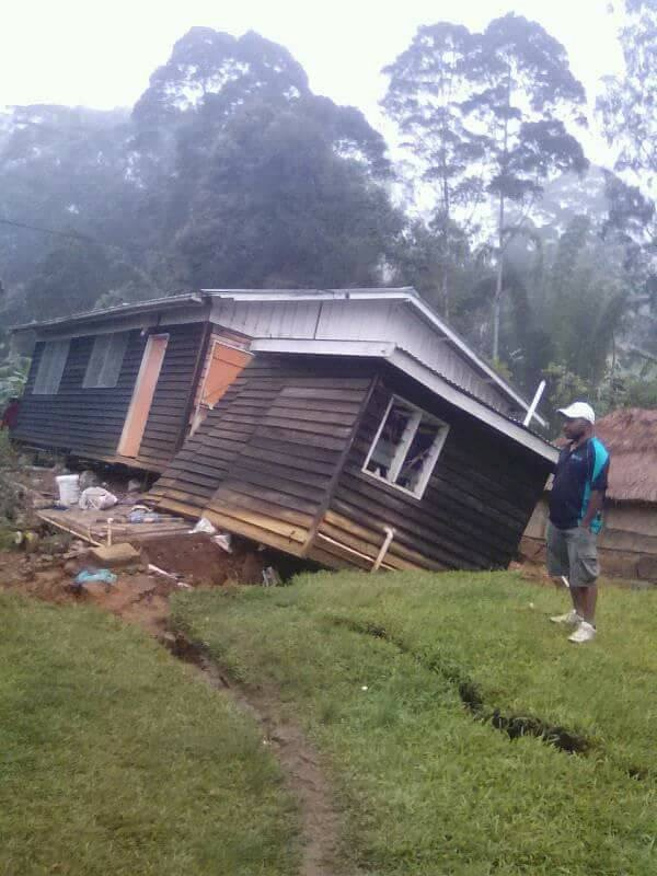 A local stands next to a damaged house near a landslide in the town of Tari after an earthquake struck Papua New Guinea's Southern Highlands in this image taken February 27, 2018 obtained from social media. Francis Ambrose/via REUTERS ATTENTION EDITORS - THIS IMAGE WAS PROVIDED BY A THIRD PARTY. NO RESALES. NO ARCHIVES. MANDATORY CREDIT?