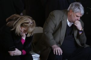 India and Greg Keith, family friends of the Grahams, pray before the funeral service for the late U.S. evangelist Billy Graham at the Billy Graham Library in Charlotte, North Carolina, U.S., March 2, 2018. REUTERS/Leah Millis