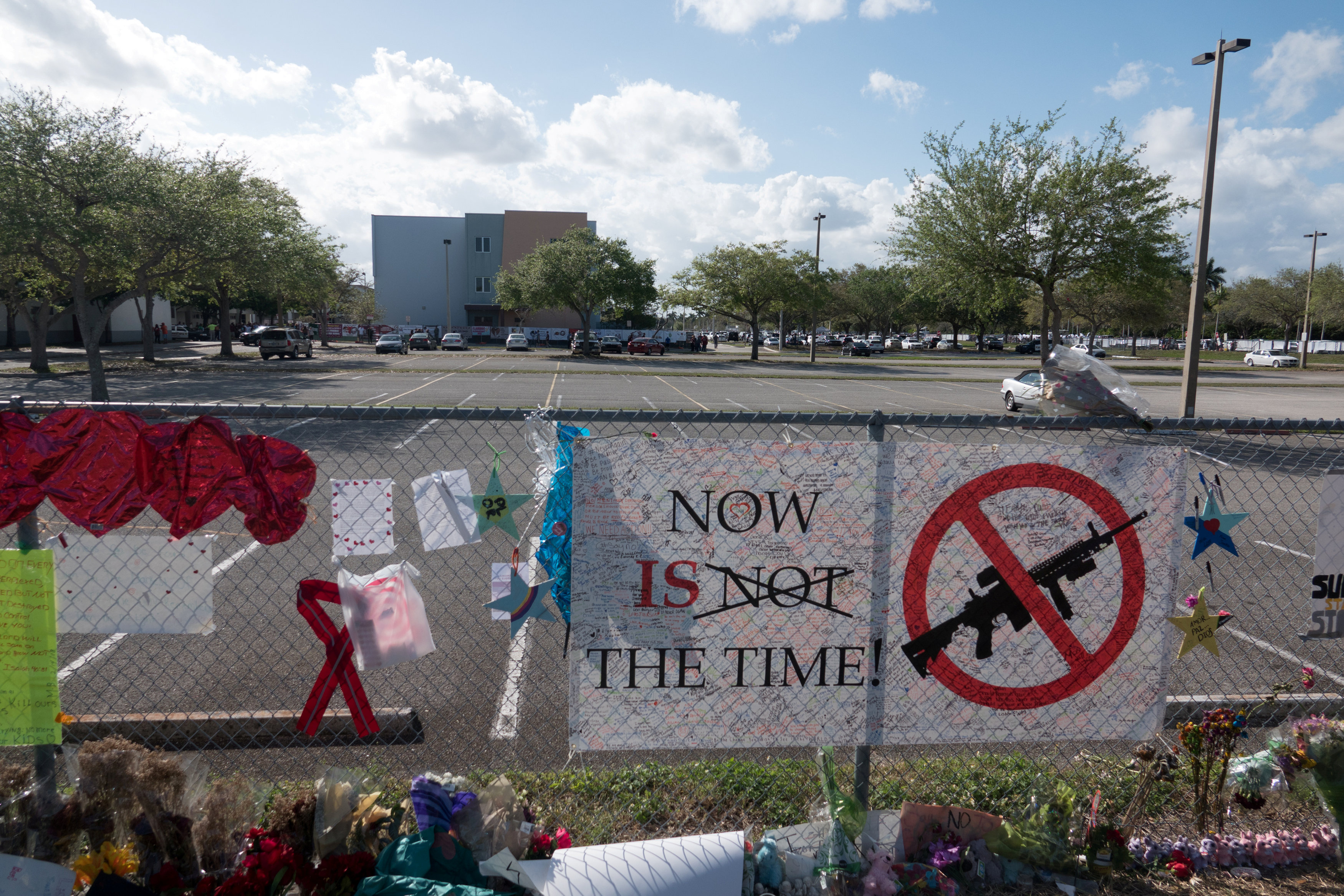 FILE PHOTO: Messages, posted on a fence, hang, as students and parents attend a voluntary campus orientation at the Marjory Stoneman Douglas High School, for the coming Wednesday's reopening, following last week's mass shooting in Parkland, Florida, U.S., February 25, 2018. REUTERS/Angel Valentin/File photo