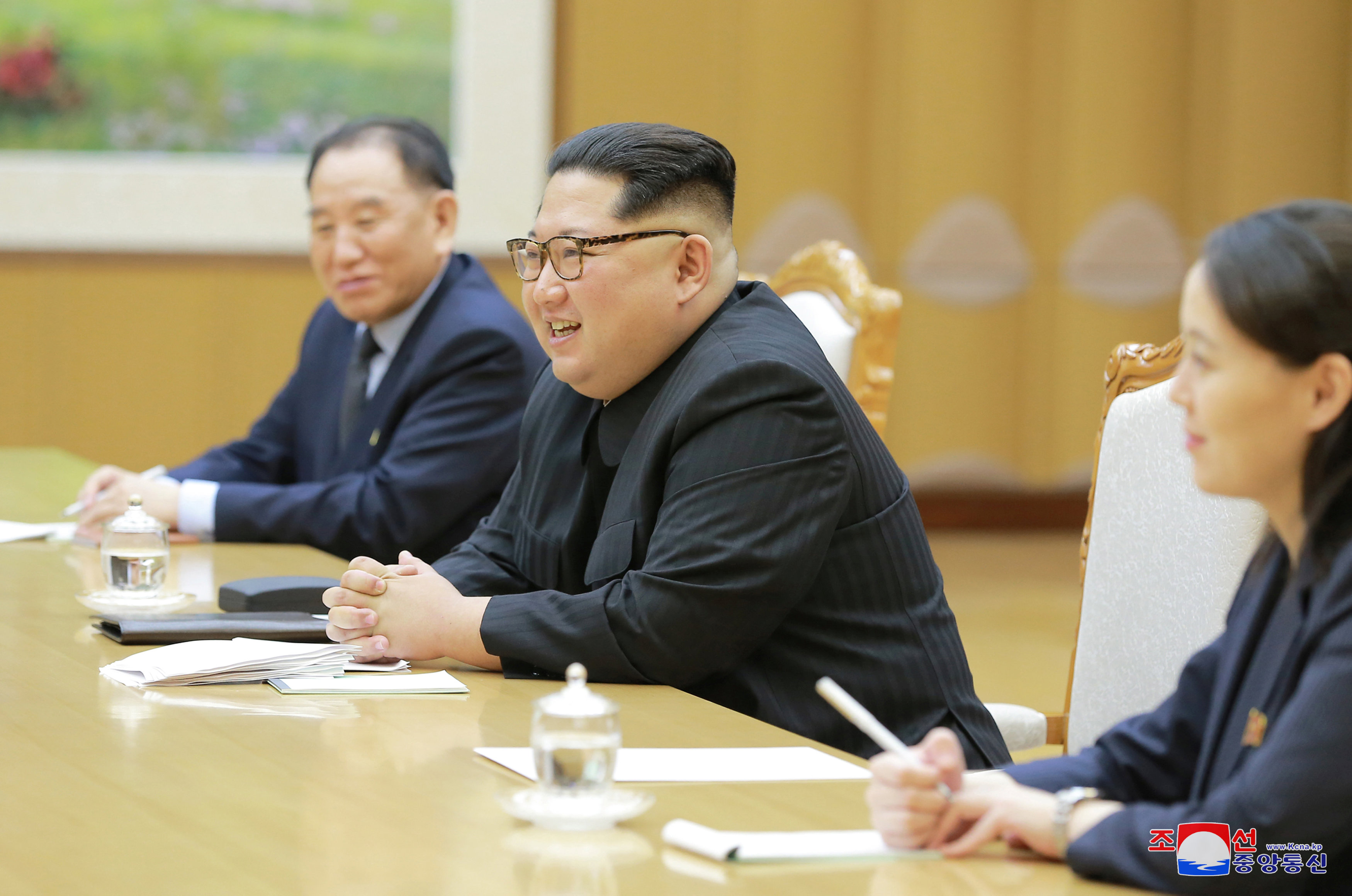 North Korean leader Kim Jong Un meets members of the special delegation of South Korea's President in this photo released by North Korea's Korean Central News Agency (KCNA) on March 6, 2018. KCNA/via Reuter