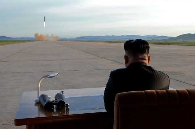 FILE PHOTO: North Korean leader Kim Jong Un watches the launch of a Hwasong-12 missile in this undated photo released by North Korea's Korean Central News Agency (KCNA) on September 16, 2017. KCNA via REUTERS/File Photo