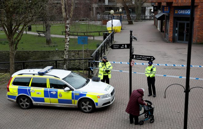 Police officers continue to guard the scene where a forensic tent, covering the bench where Sergei Skripal and his daughter Yulia were found, has been erected in the centre of Salisbury, Britain, March 9, 2018. REUTERS/Peter Nicholls