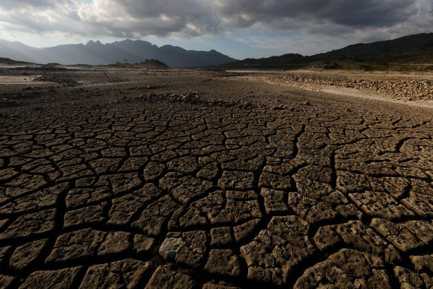 Sand blows across a normally submerged area at Theewaterskloof dam near Cape Town, South Africa, January 21, 2018. REUTERS/Mike Hutchings