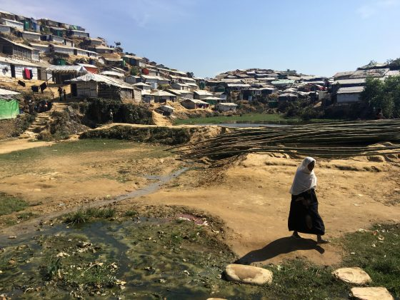 A woman walks through the Chakmakul camp for Rohingya refugees in southern Bangladesh, February 13, 2018. REUTERS/Andrew RC Marshall