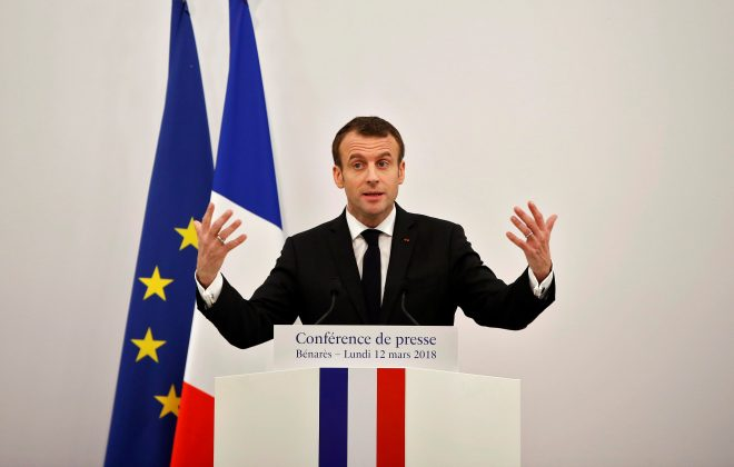FILE PHOTO: French President Emmanuel Macron gestures as he addresses a news conference in Varanasi, India, March 12, 2018. REUTERS/Adnan Abidi