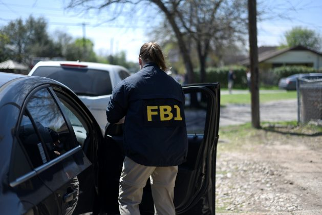 An FBI agent exits her car after arriving at the scene of an explosion near north Galindo street. Police investigators are at the home where a 17-year-old boy was killed and a woman injured in a package bomb explosion in Austin, Texas, U.S., March 12, 2018. REUTERS/Sergio Flo