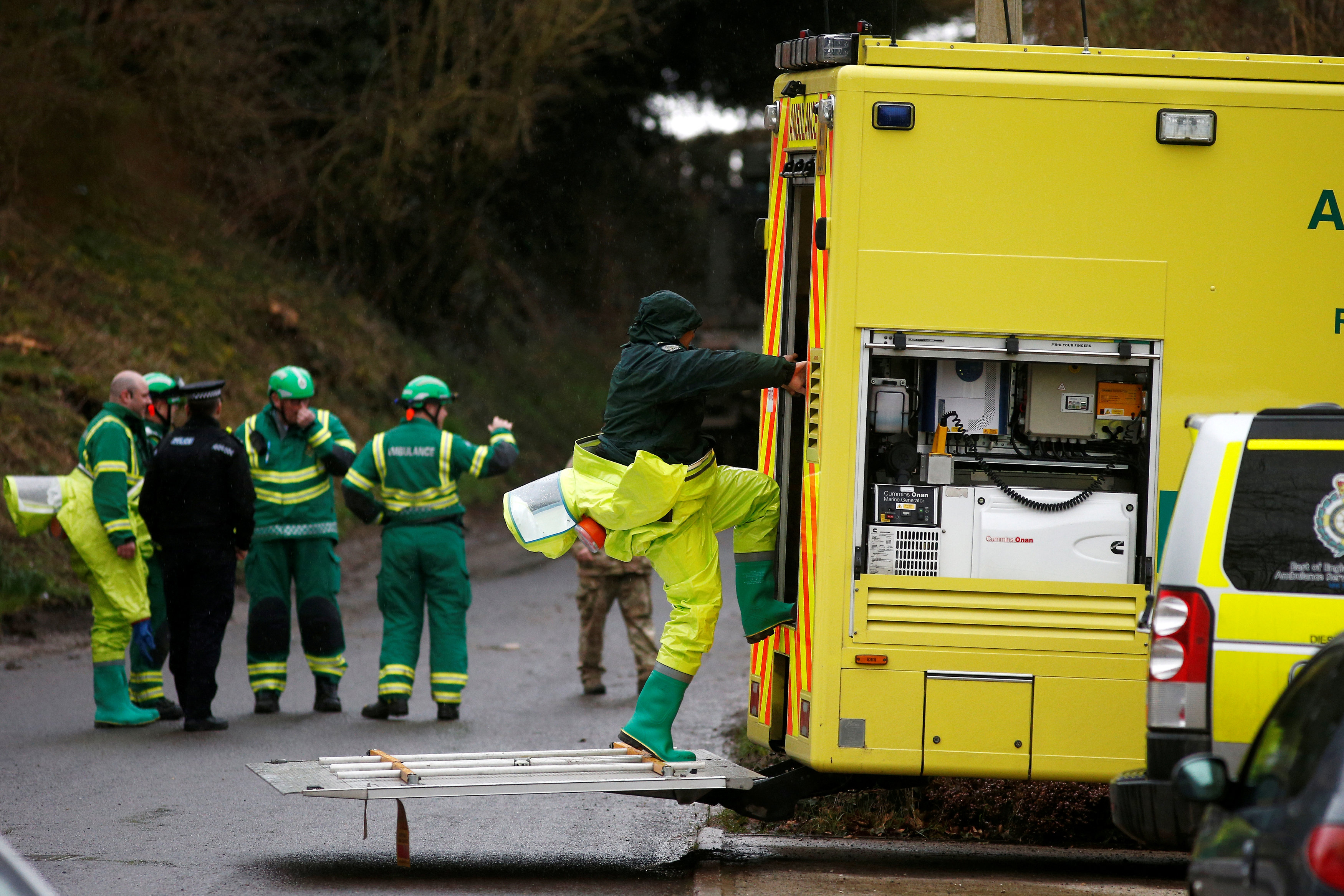 Members of the emergency services wearing protective suits work at a site in Winterslow, near Salisbury, Britain, March 12, 2018. REUTERS/Henry Nicholls
