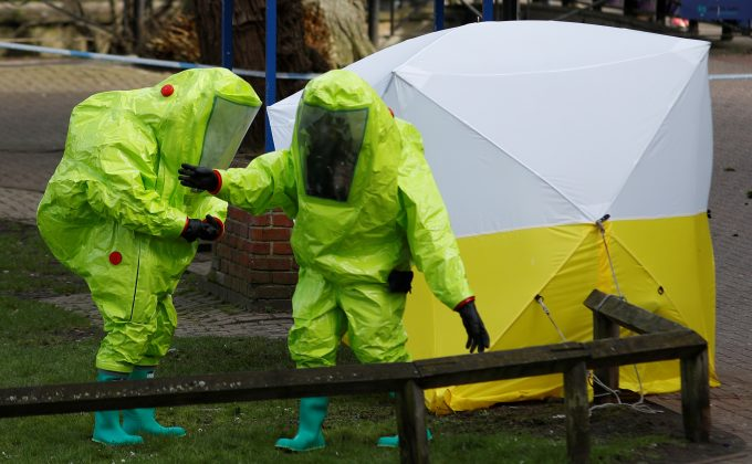The forensic tent, covering the bench where Sergei Skripal and his daughter Yulia were found, is repositioned by officials in protective suits in the centre of Salisbury, Britain, March 8, 2018. REUTERS/Peter Nicho