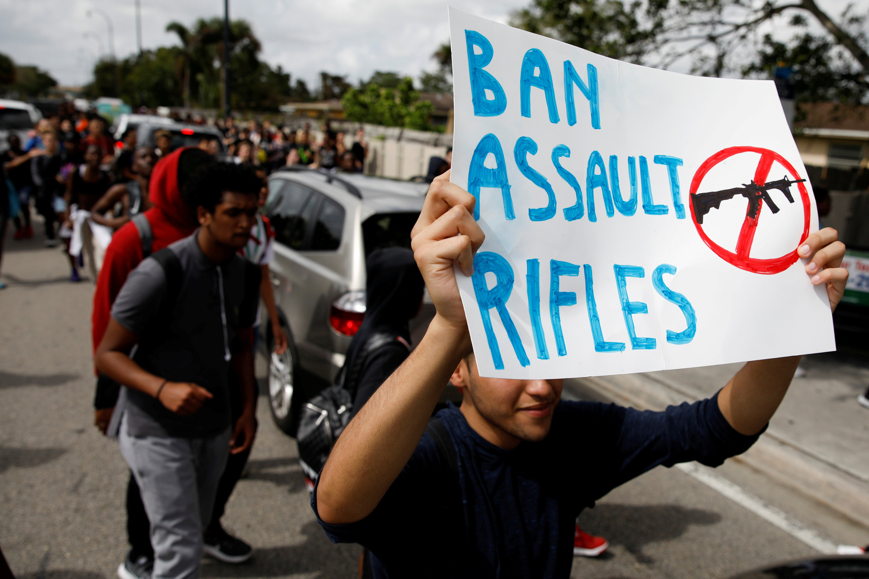FILE PHOTO: Students from South Plantation High School carrying placards and shouting slogans walk on the street during a protest in support of the gun control, following a mass shooting at Marjory Stoneman Douglas High School, in Plantation, Florida, February 21, 2018. REUTERS/Carlos Garcia Rawlins/File Photo